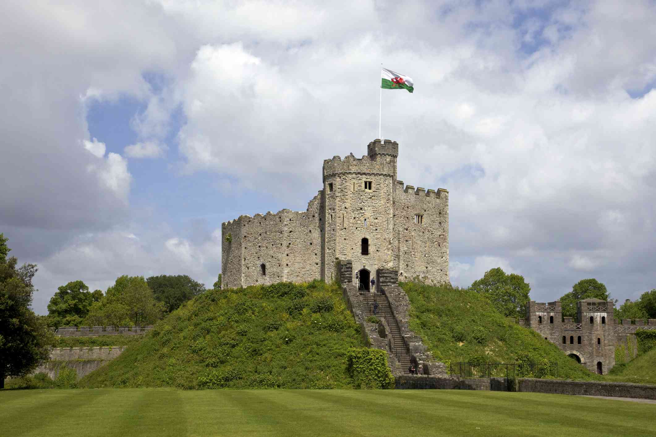 Cardiff Castle on top of a small green hill on a cloudy day