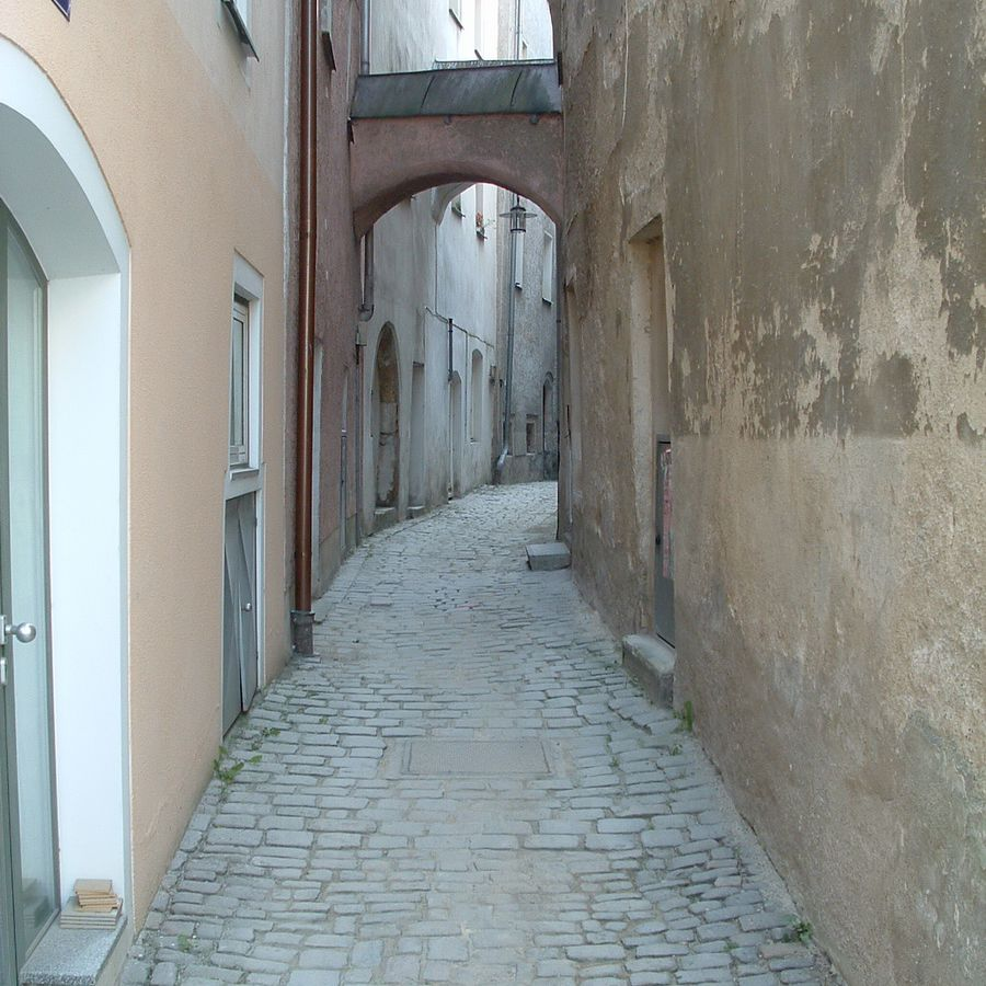 A narrow pedestrian lane in Old Town Passau, Germany
