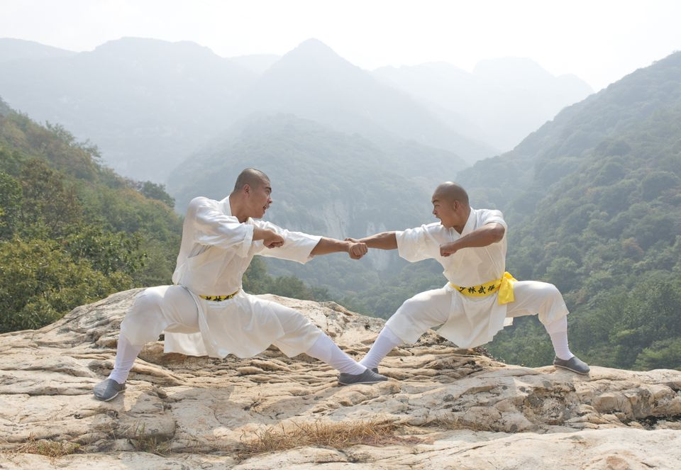 Shaolin monk kung fu experts practice near Shaolin Temple on Mt. Song