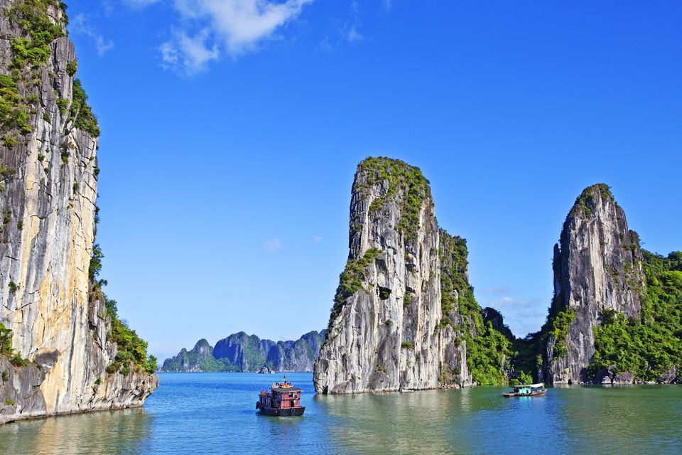 Boats on Ha Long Bay, World Heritage site with limestone Karsts and mountains