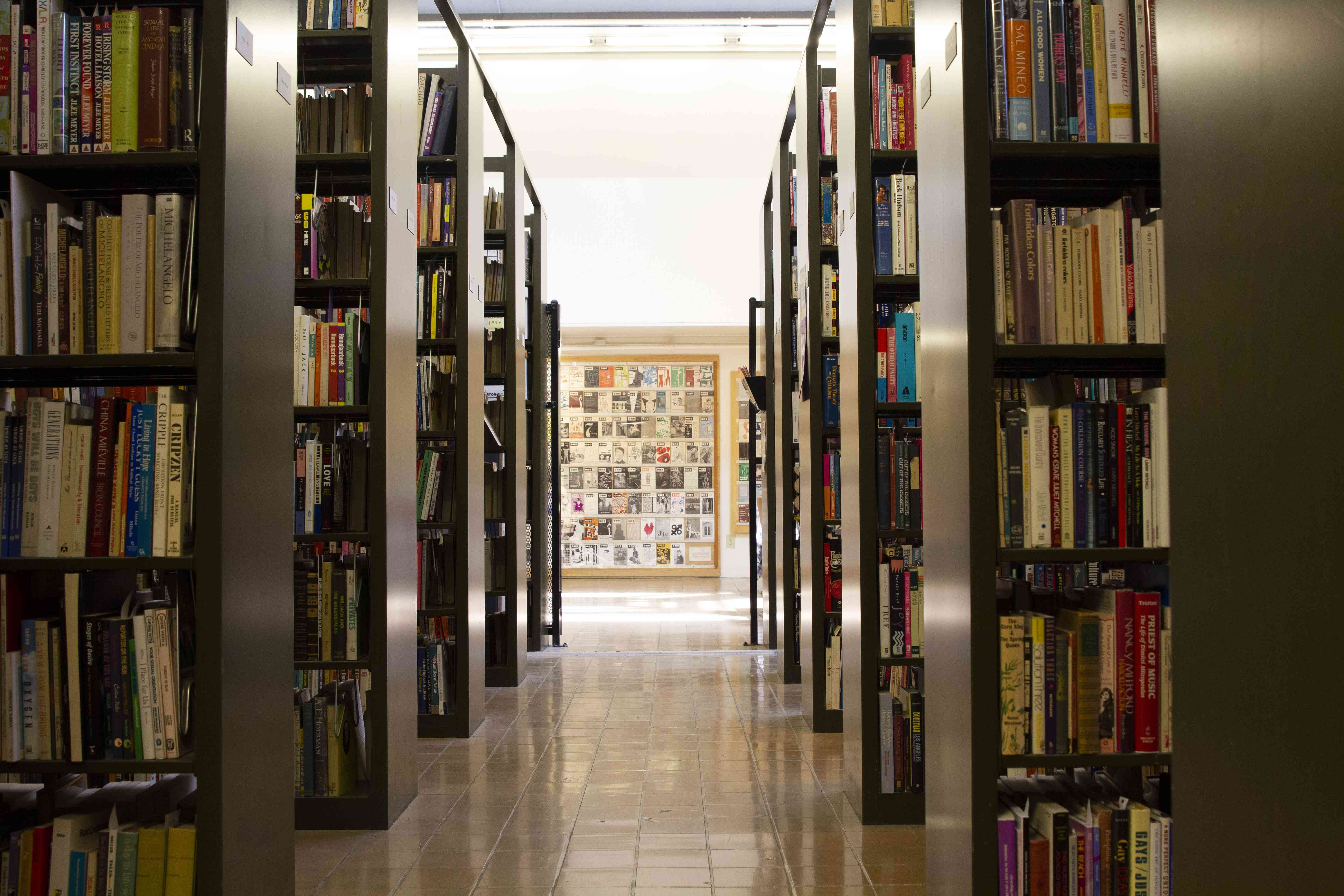 Shelves of books at ONE Archives