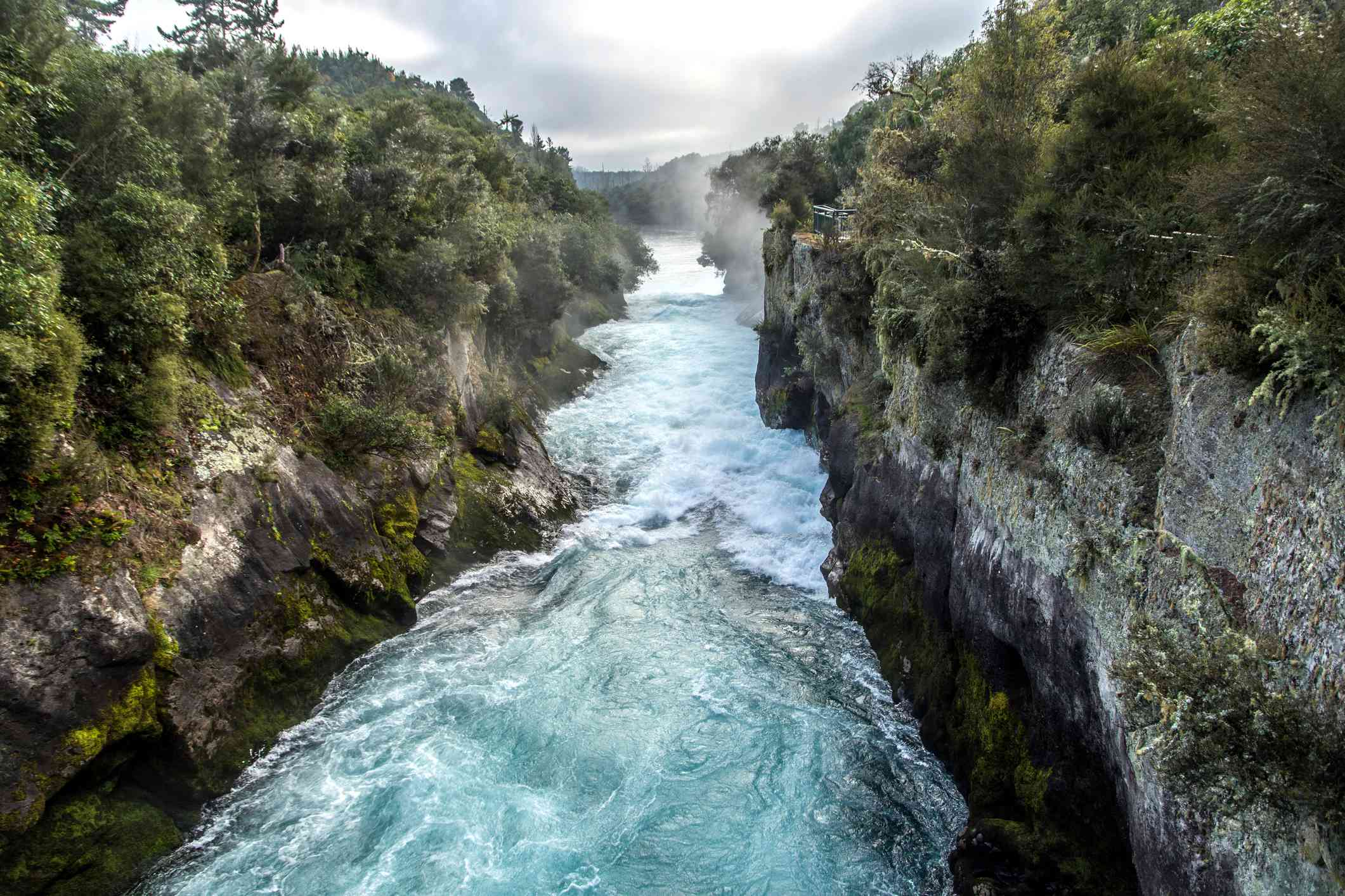 narrow canyon with blue and white waters of a river rushing through