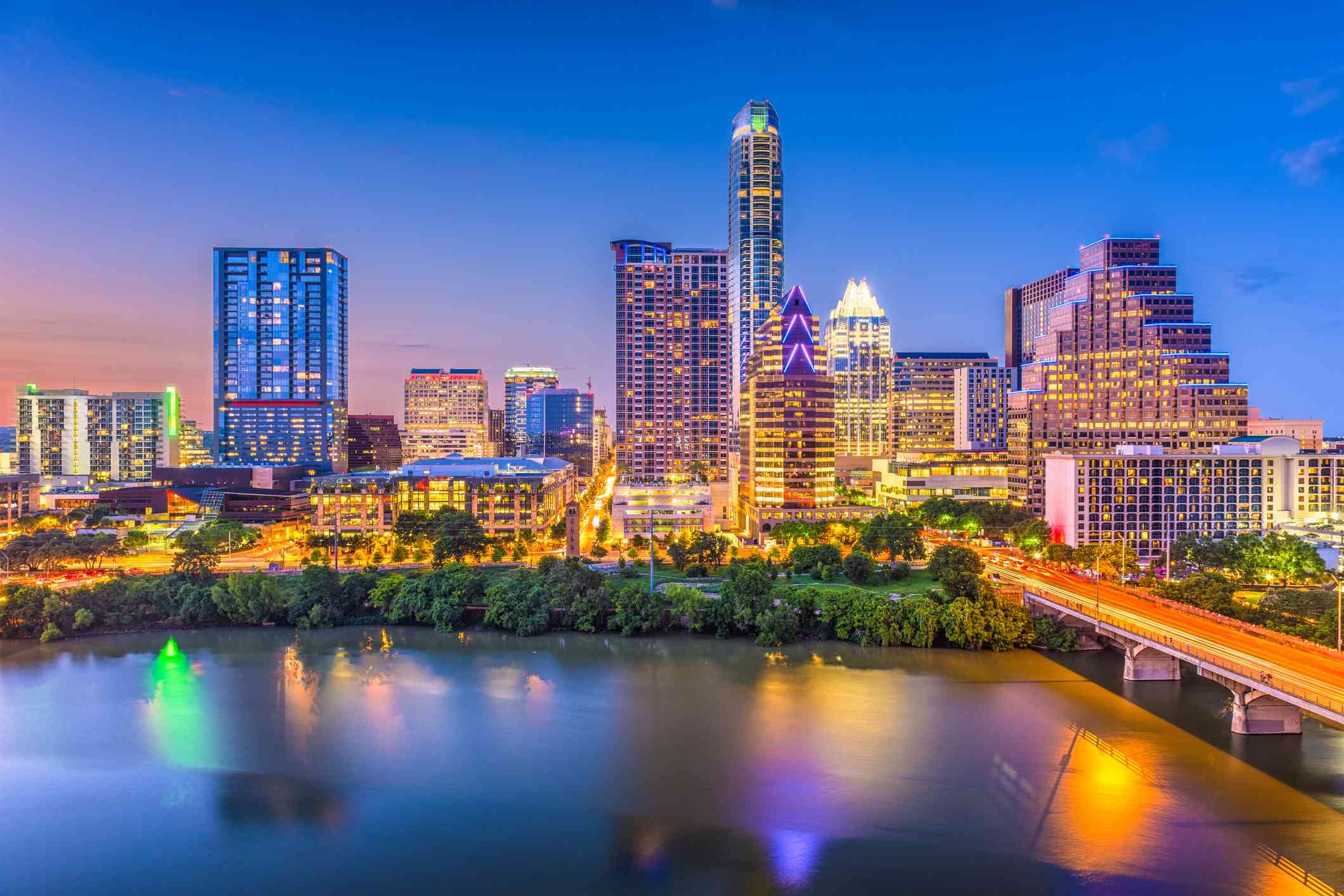 downtown skyline of austin texas over the Colorado River at twilight