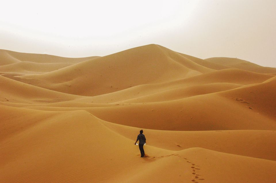 Person standing in the desert in Morocco