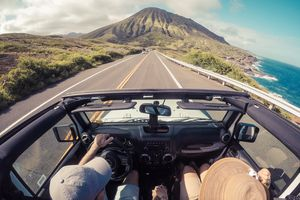 Rear view of a couple driving in a convertible, Lahaina, Maui, Hawaii, America, USA