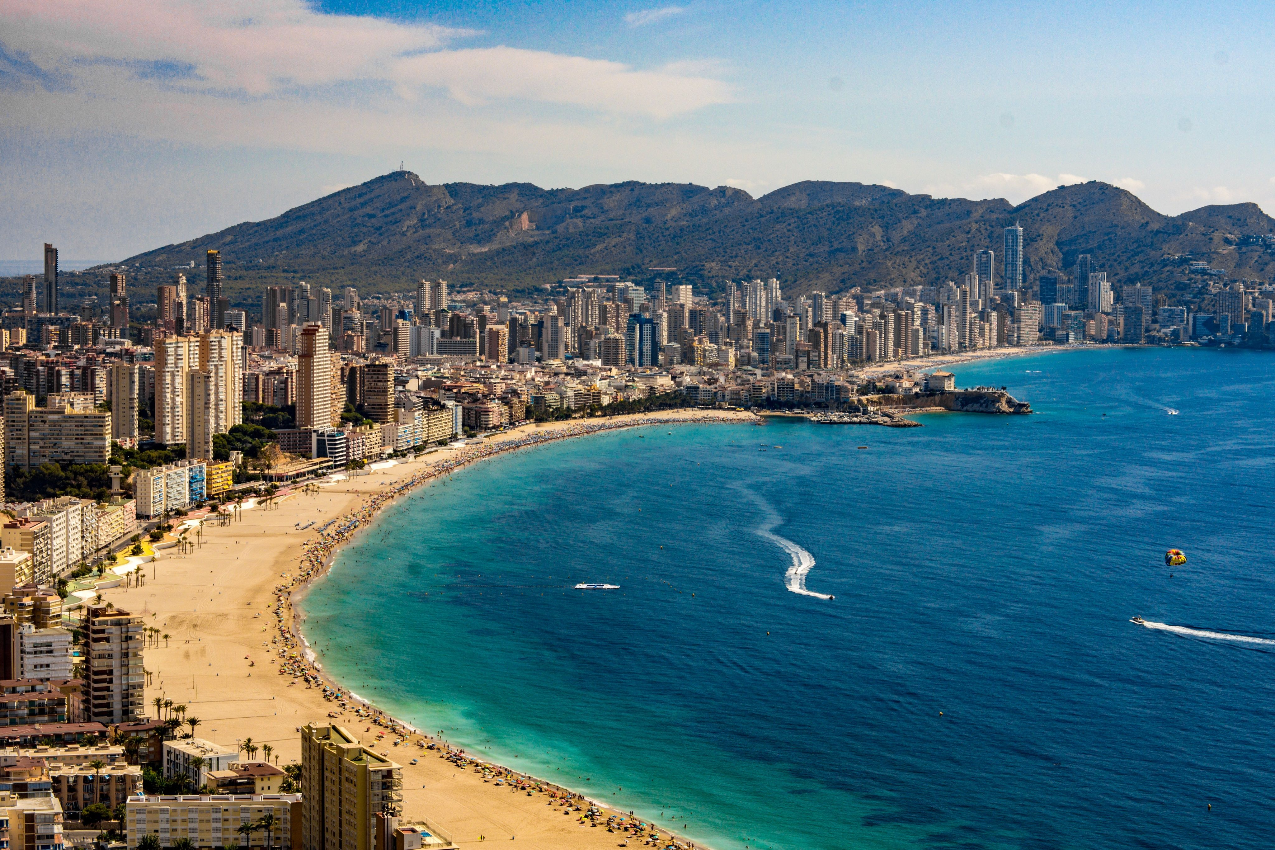 High Angle View Of Sea And Benidorm Cityscape Against Sky