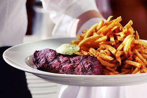 hanger steak served with julienne fries