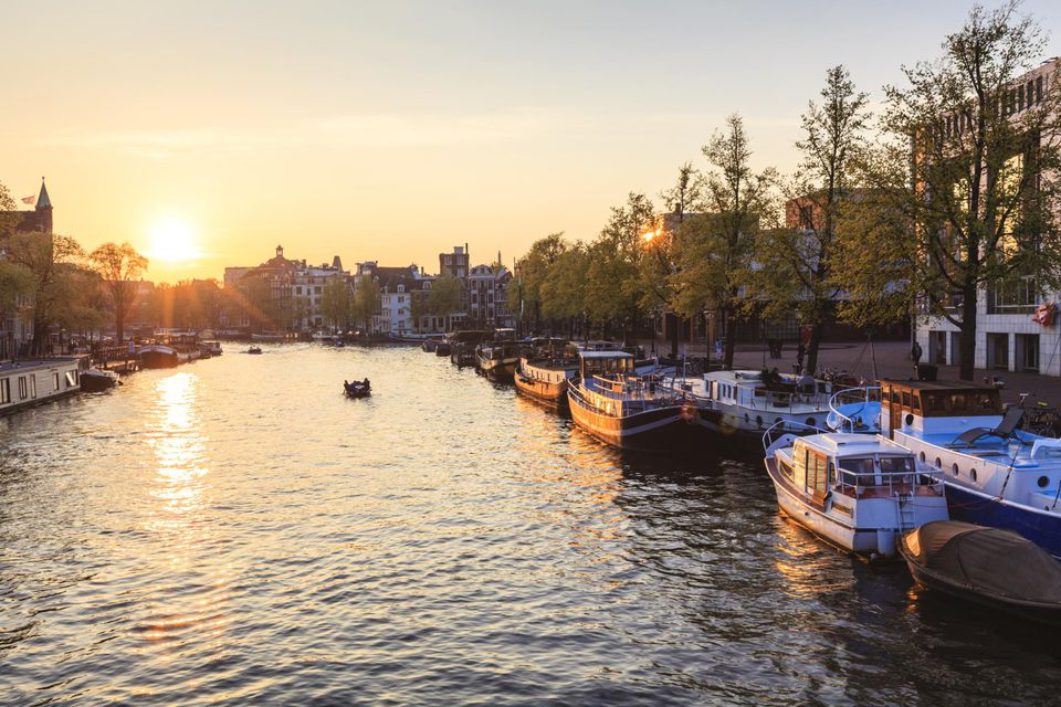 Amsterdam sunset Amstel river at sunset