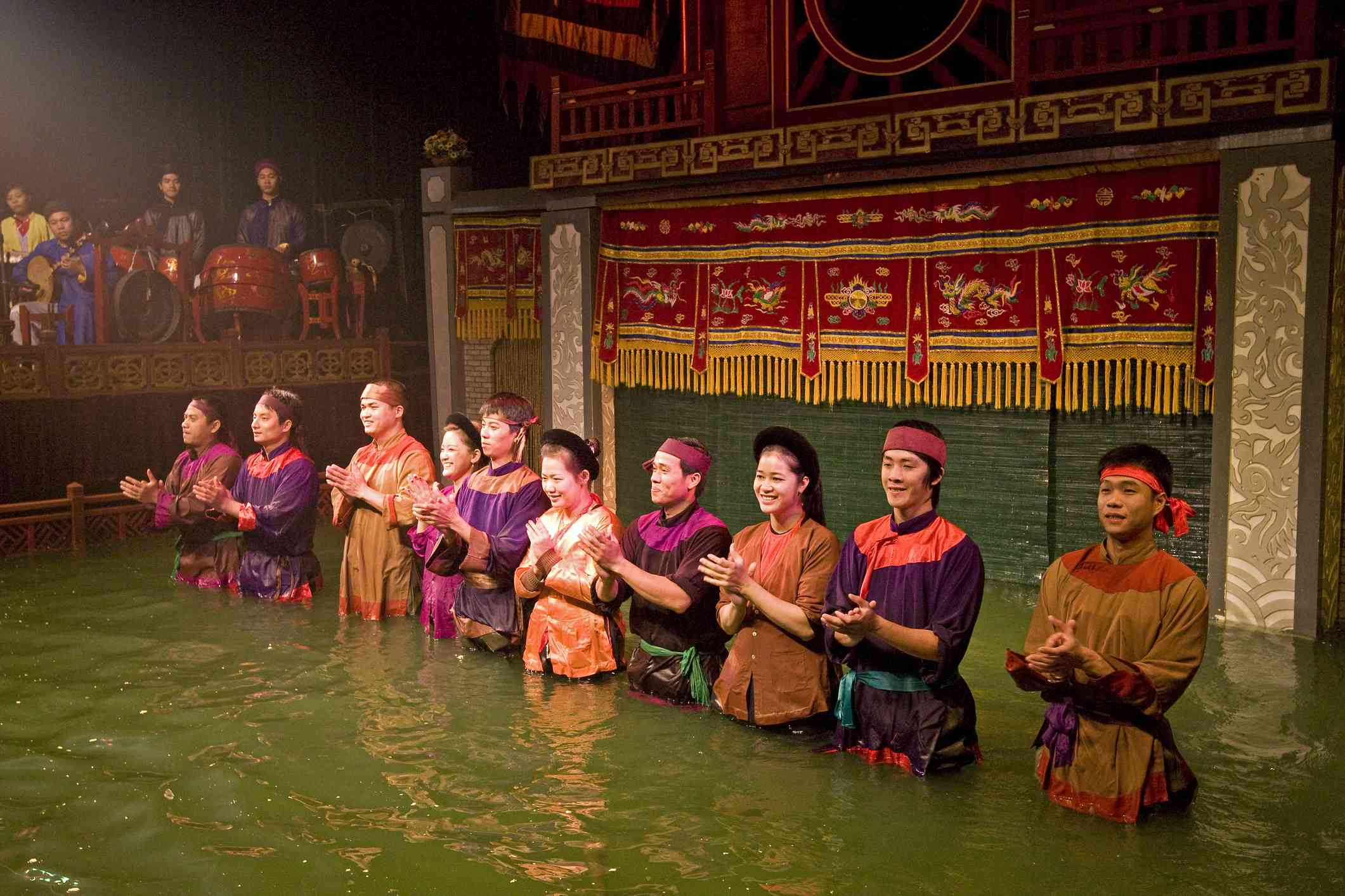 Water puppeteers take a curtain call