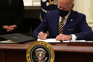 President Joe Biden signing mandate about self quarantining during the Covid 19 pandemic