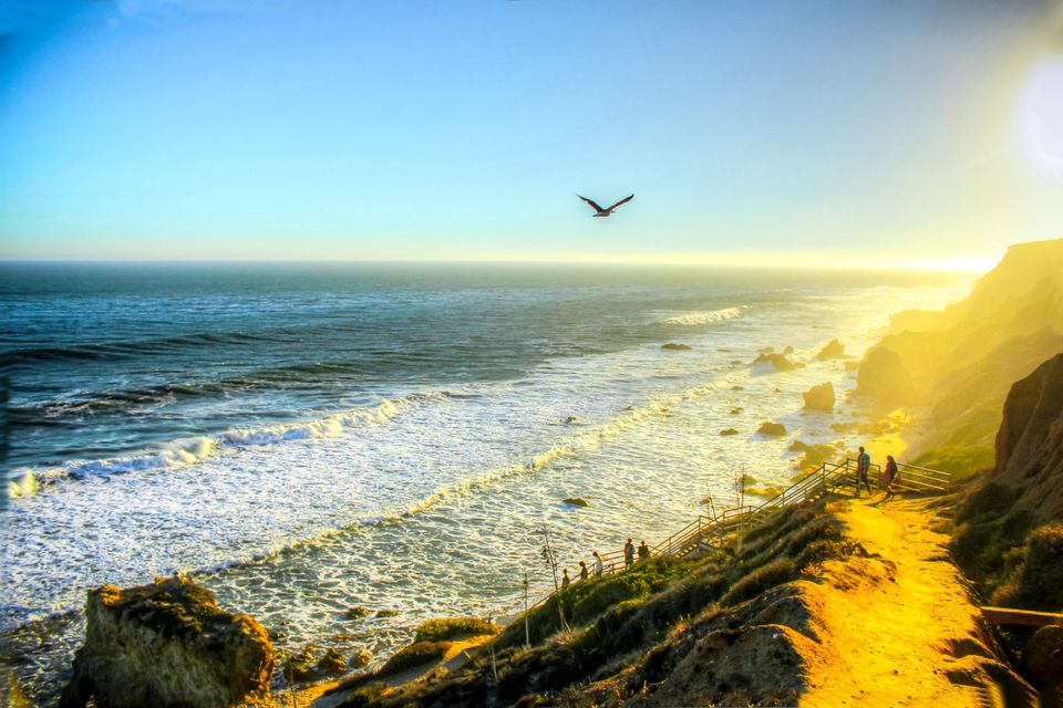 Beach goers hiking down to Malibu Beach