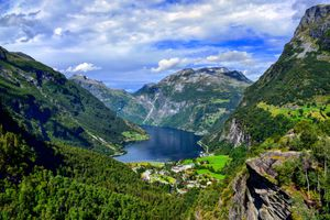 Scenic View Of Trees And Mountains Against Sky in Geiranger