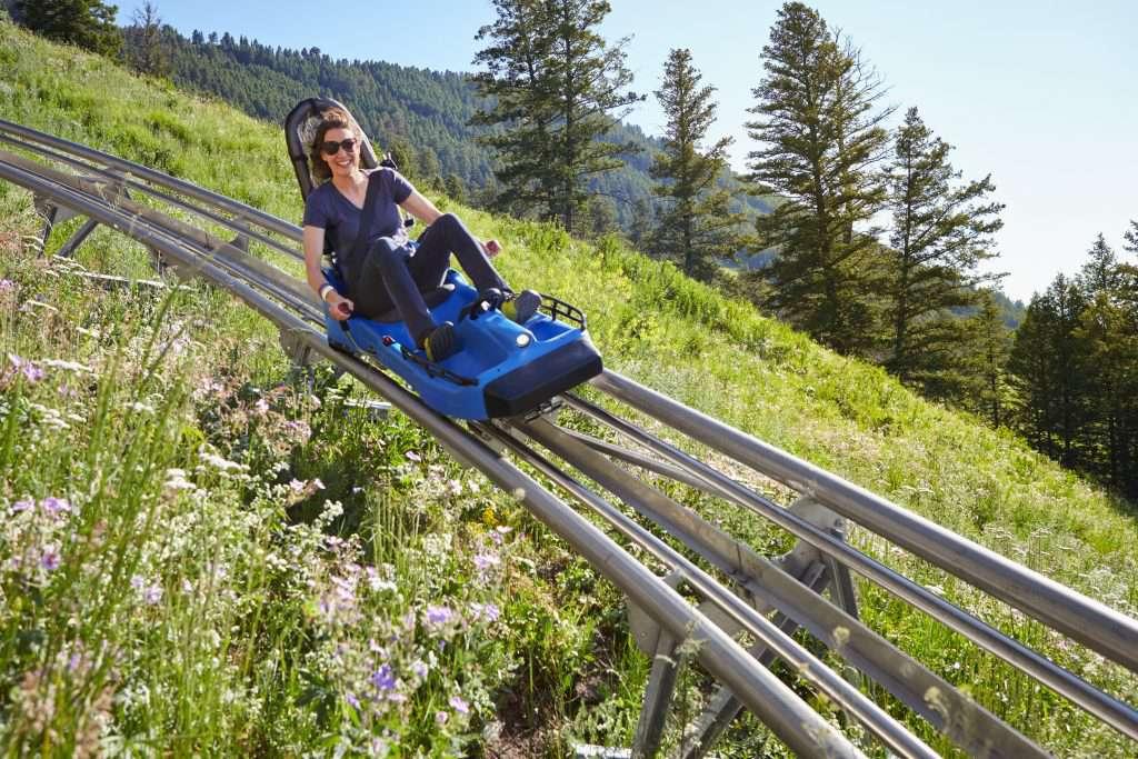 Woman riding the coaster at Snow King Mountain