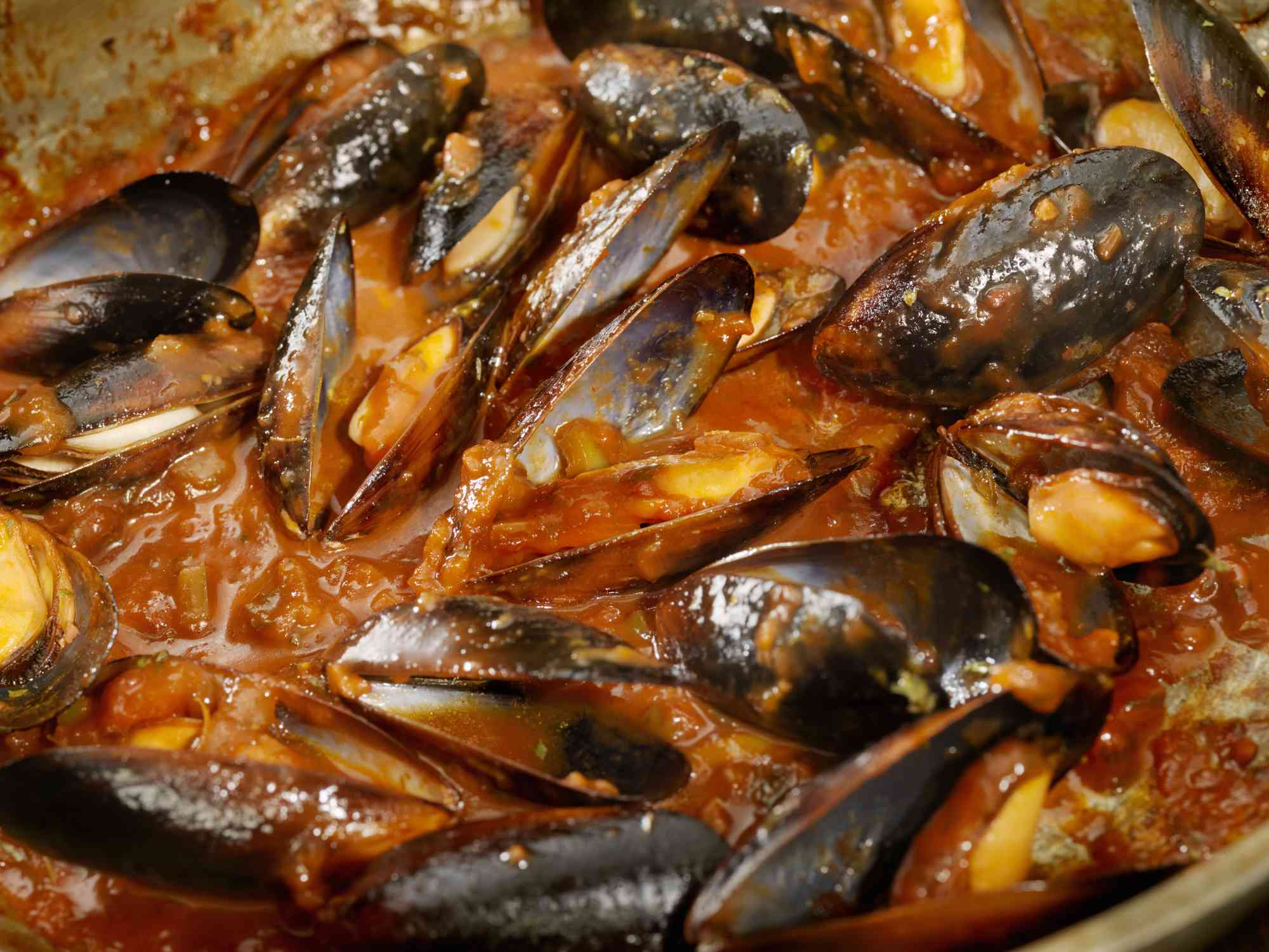Close-up of a bowl of mussels in tomato sauce