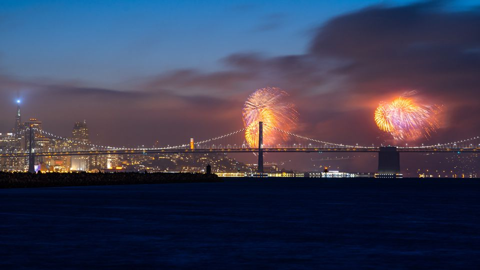 Fourth of July Fireworks Over Bay Bridge and San Francisco Skyline viewed from Alameda Island, California, USA