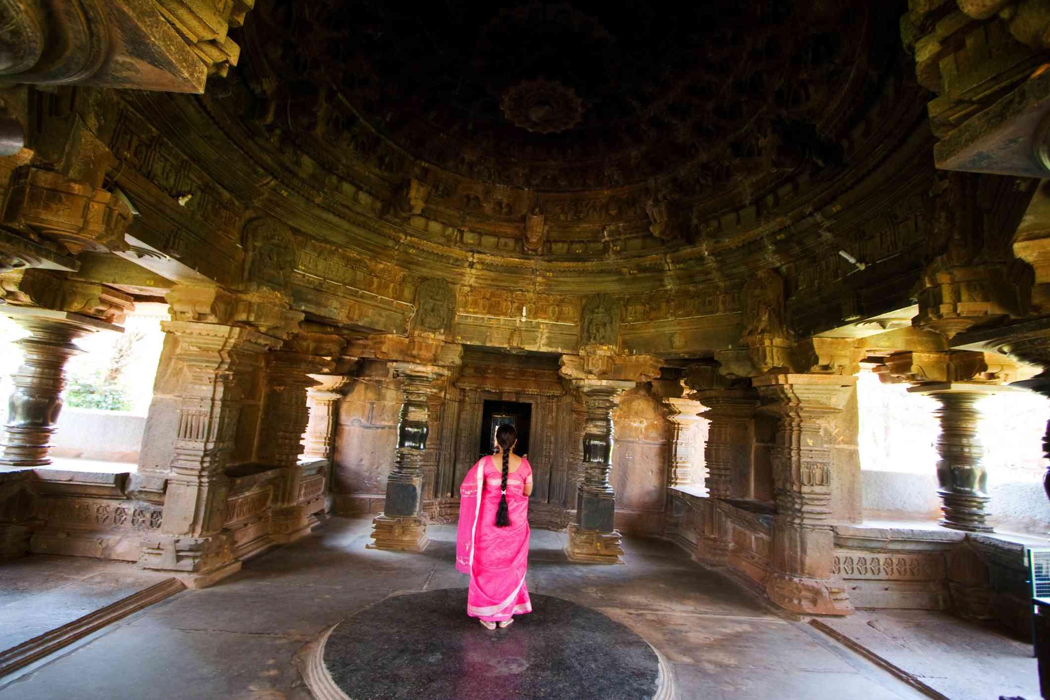 Woman praying in jain old temple kamal basti at Belgaum, Karnataka