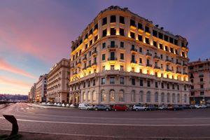 Exterior of the Eurostars Hotel Excelsior, at dusk, Naples