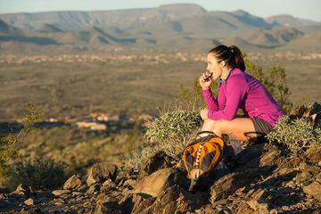 Woman having snack during hike