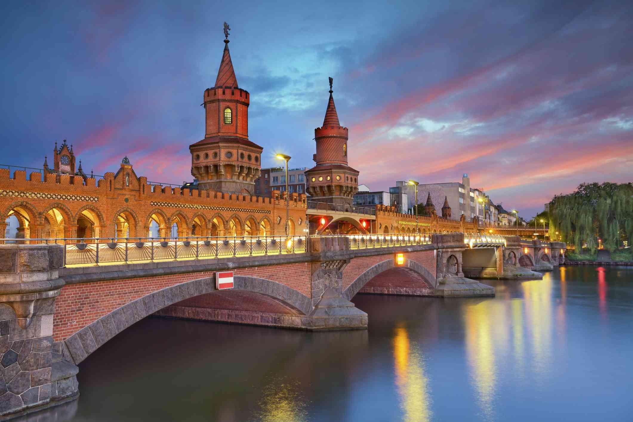 Image of Oberbaum Bridge in Berlin, during dramatic sunset.
