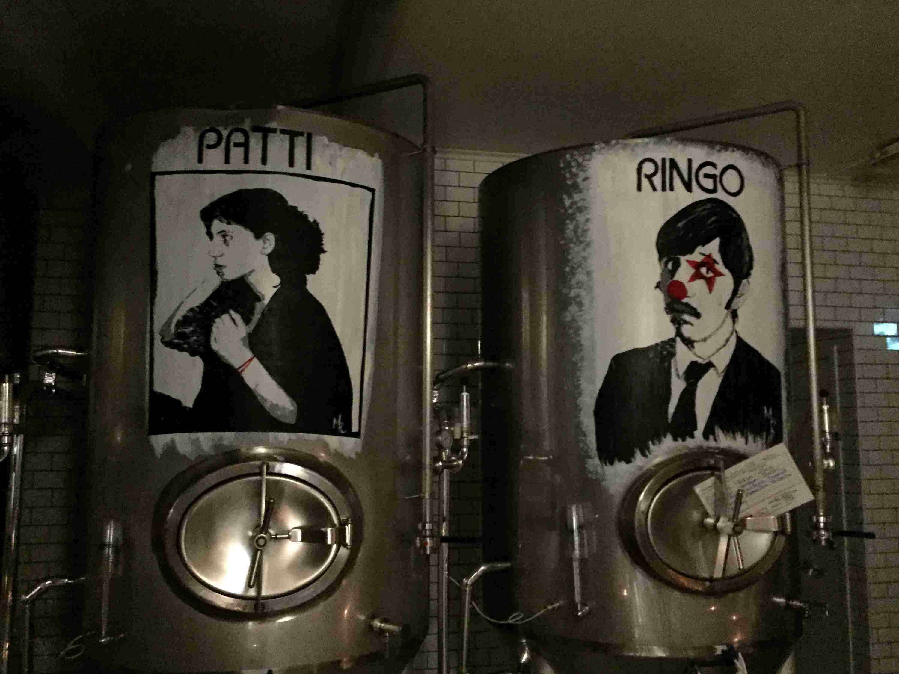 Two barrels of beer with faces drawn on each