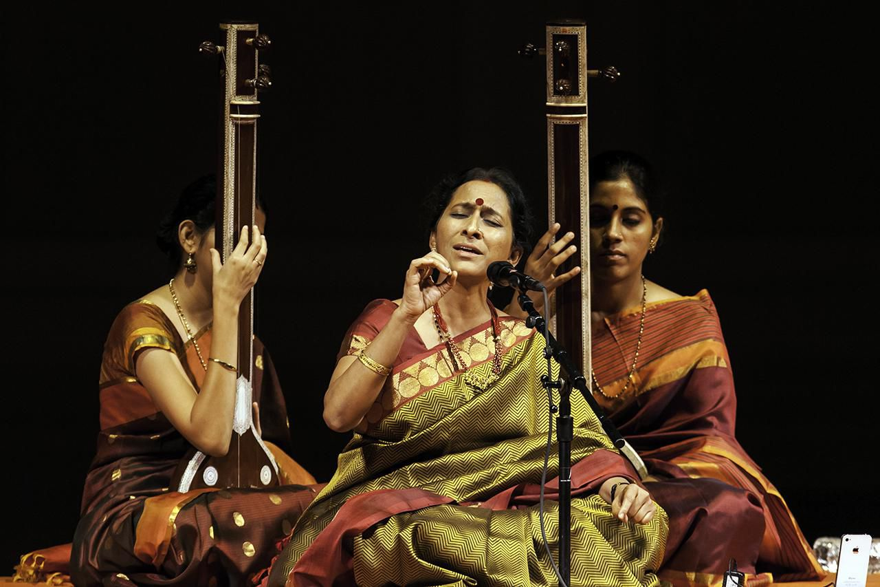 Indian musician Bombay Jayshri (aka Bombay Jayshri Ramnath) (center) signs with her ensemble during a concert of Carnatic music at Carnegie Hall, New York, New York, October 20, 2013.