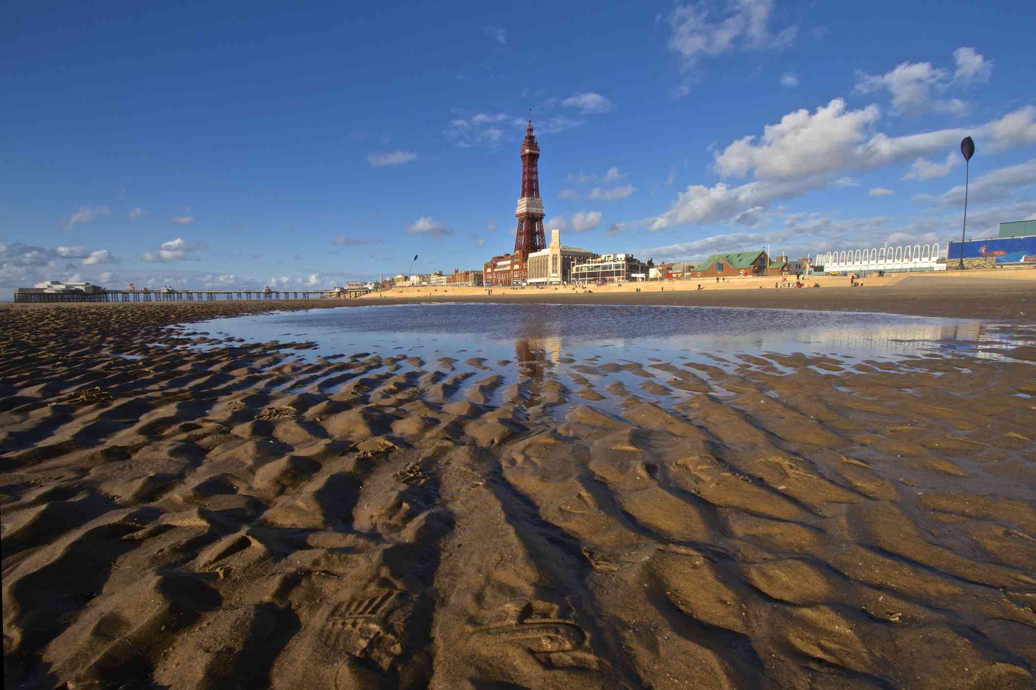 Seaside resort of Blackpool with its iconic Tower dominating the skyline and its promenade and sandy beach