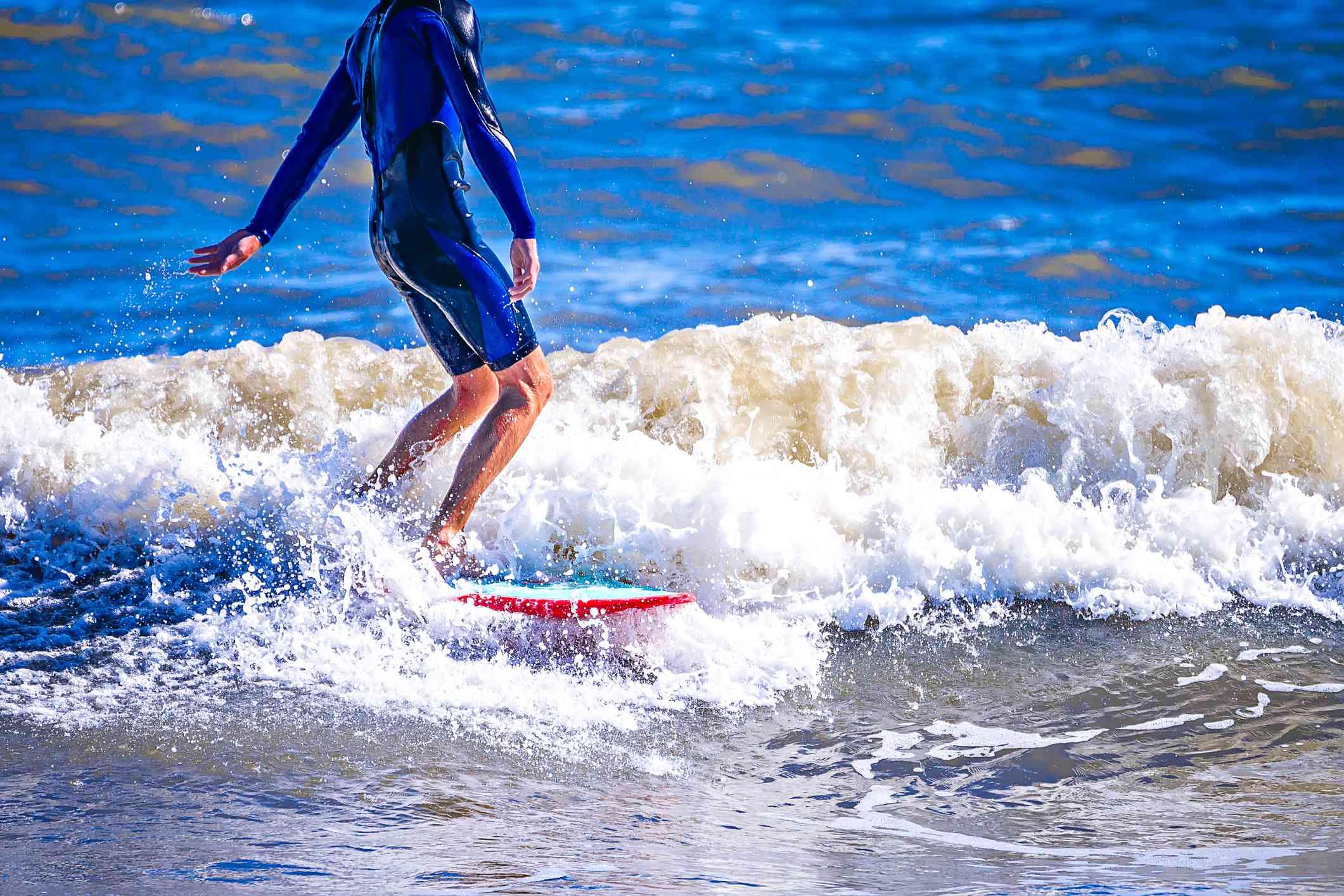 Surfer riding a wave in Folly Beach, SC