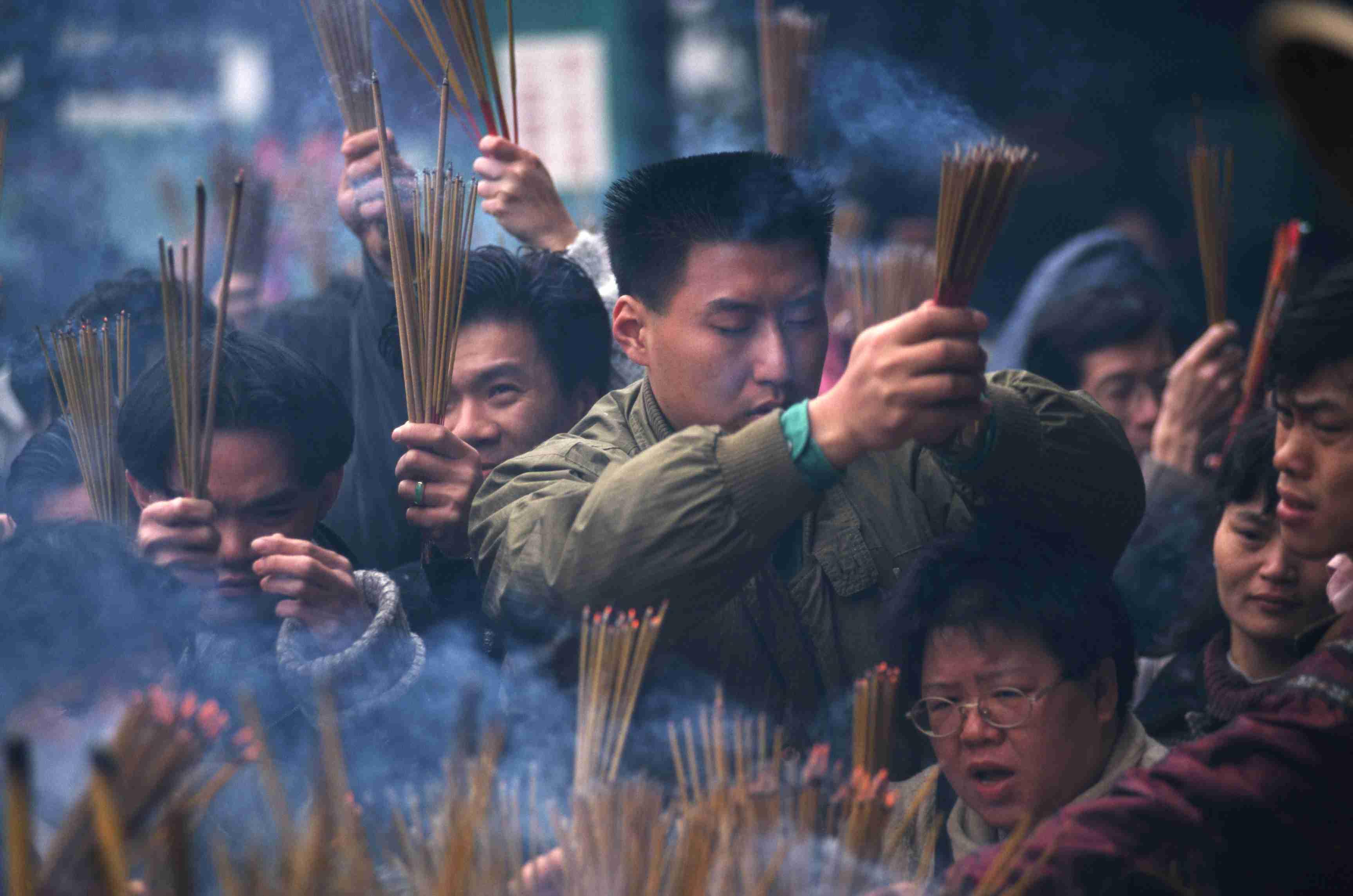 Worshipers at Wong Tai Sin Temple in Hong Kong during the Chinese New Year