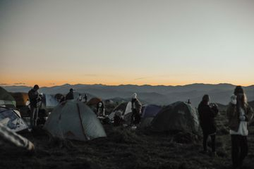 A crowded campsite at night