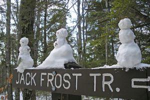 tiny snowmen on a trail sign in Massachusetts