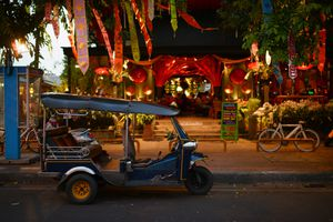 Tuktuk in front of Chiang Mai restaurant at night