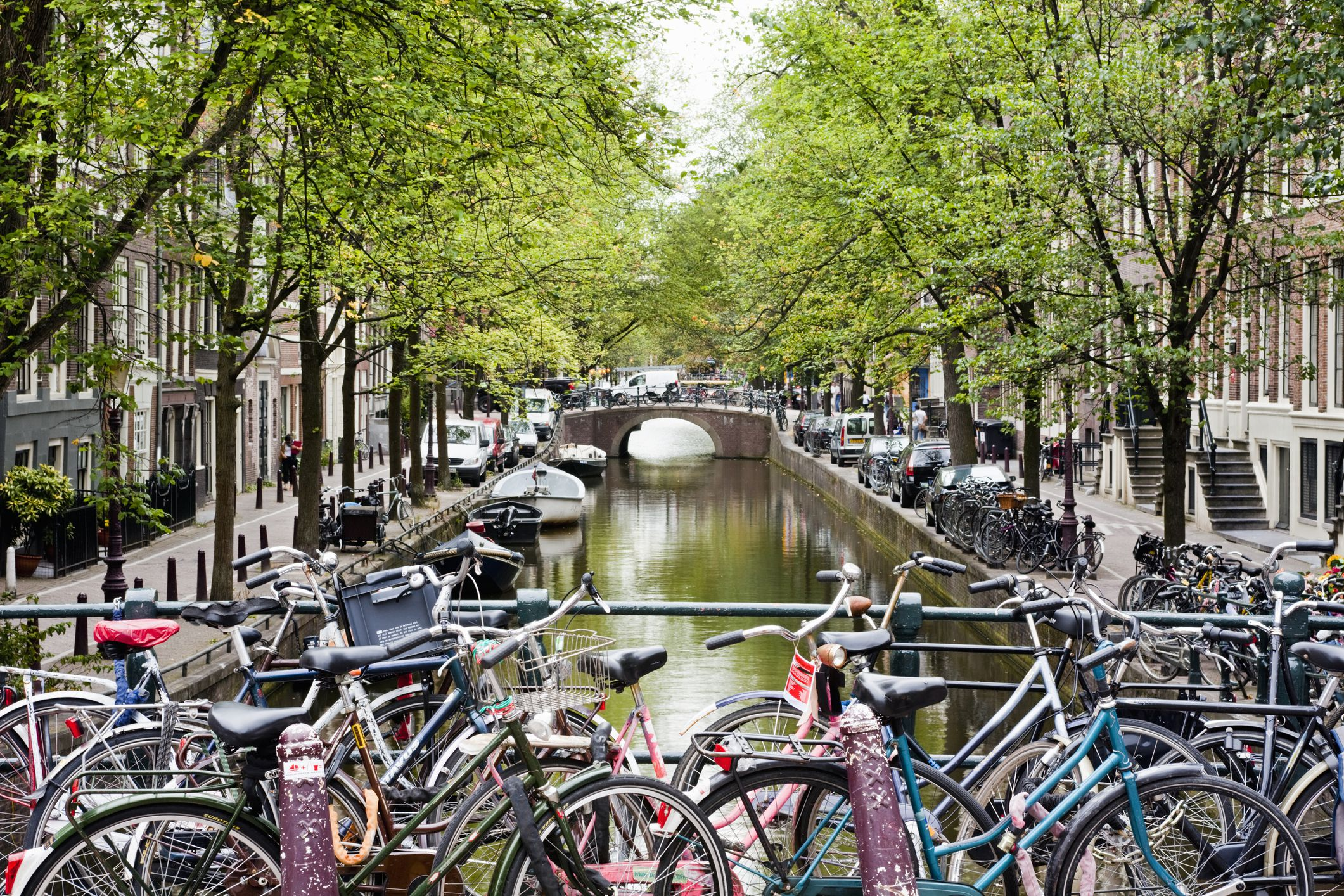 Bicycles parked on bridge over Bloemgracht canal
