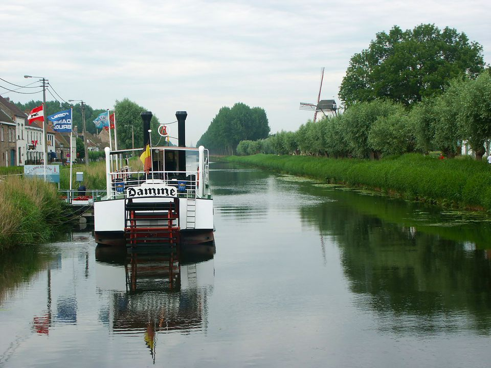Idyllic Damme, Belgium: View Along the Zwin river with Windmill