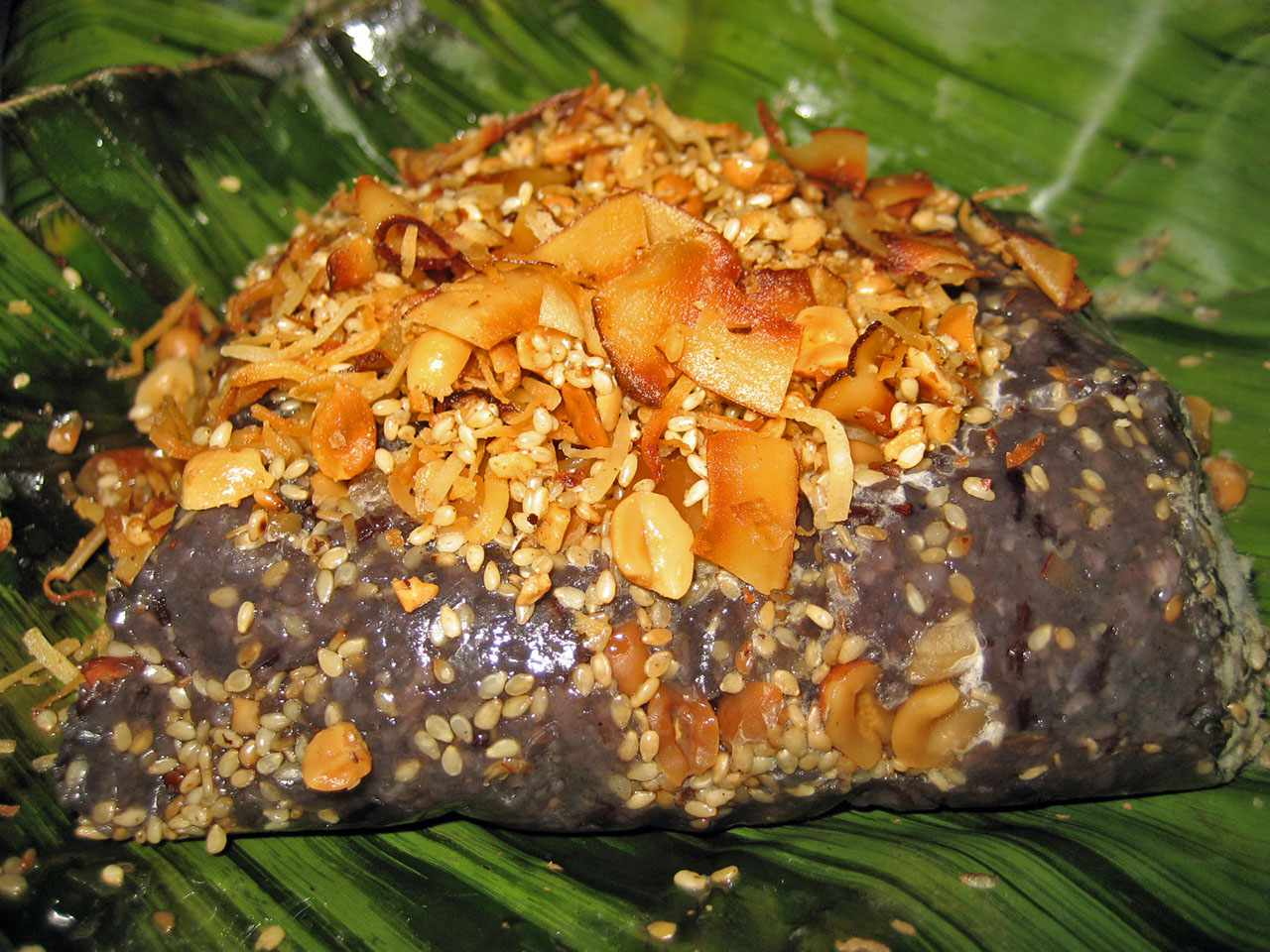 sweet rice ball with toasted nuts and seeds