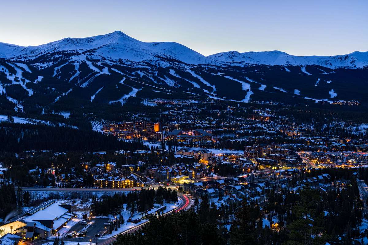 Looking down on the town of Breckenridge nestled in the mountains at dusk