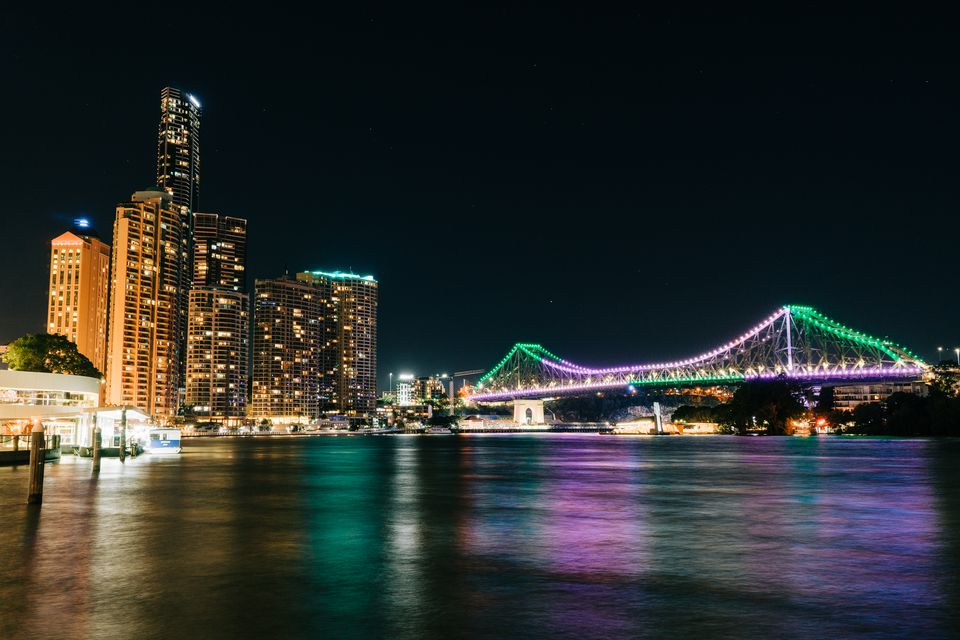 Brisbane skyline and bridge lit up at night