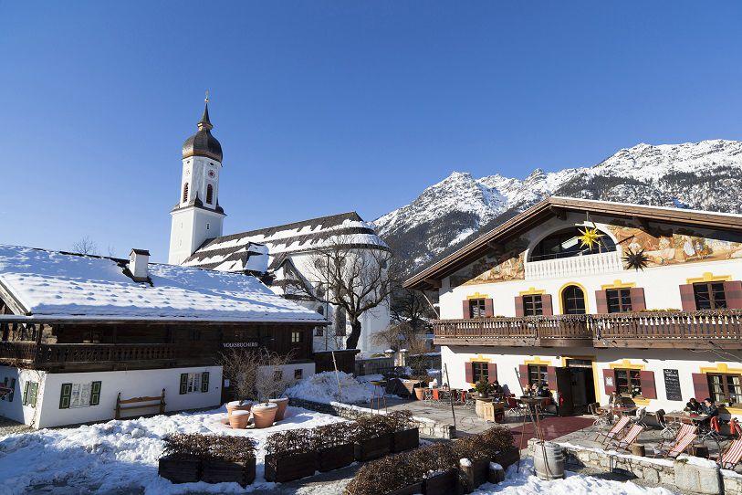 Garmisch-Partenkirchen during winter with church of Sankt Martin, Bavaria, Germany