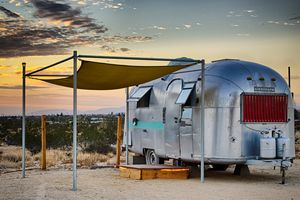 Glamping at joshua tree with desert in background