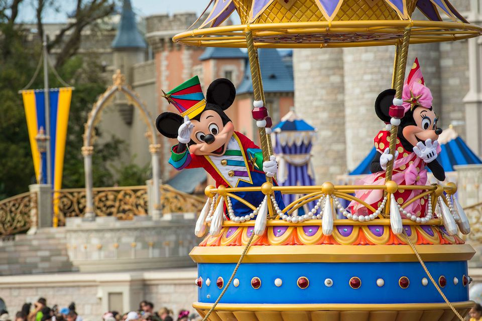 minnie and mickey mouse in a parade at disney