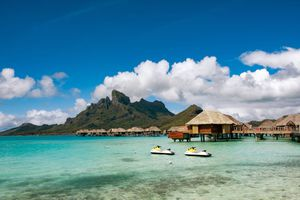 View of mountains and overwater bungalows in Bora Bora