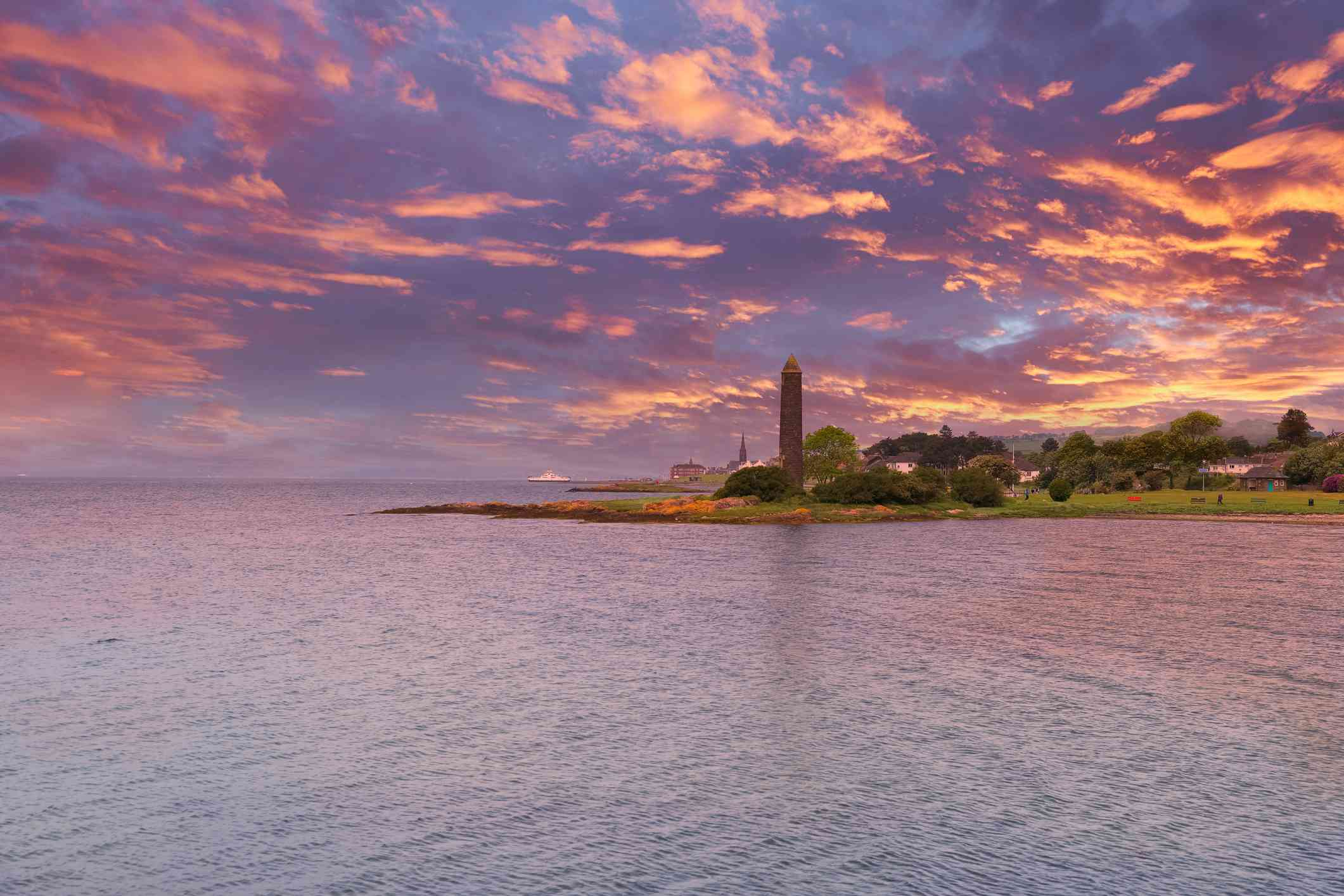 view of Largs scotland from the water with a orange and purple sunset