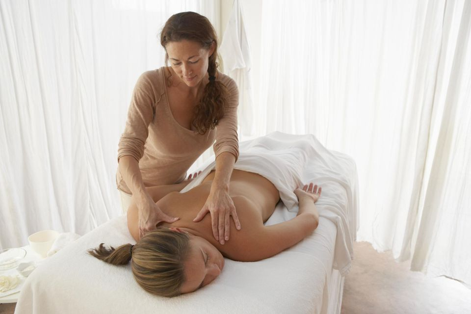 A woman receiving a Swedish massage.