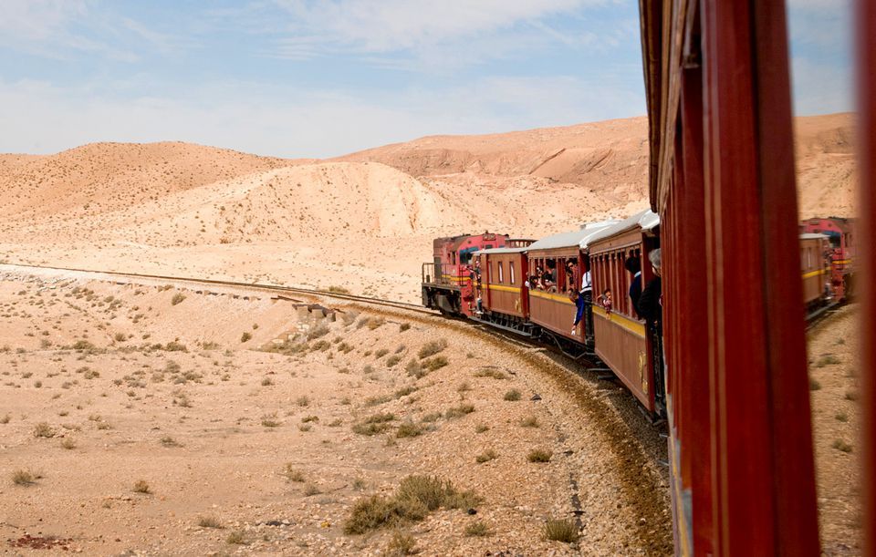 Lezard Rouge train passing through Tunisian desert