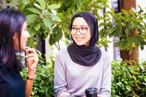 Two Malaysian women saying hello