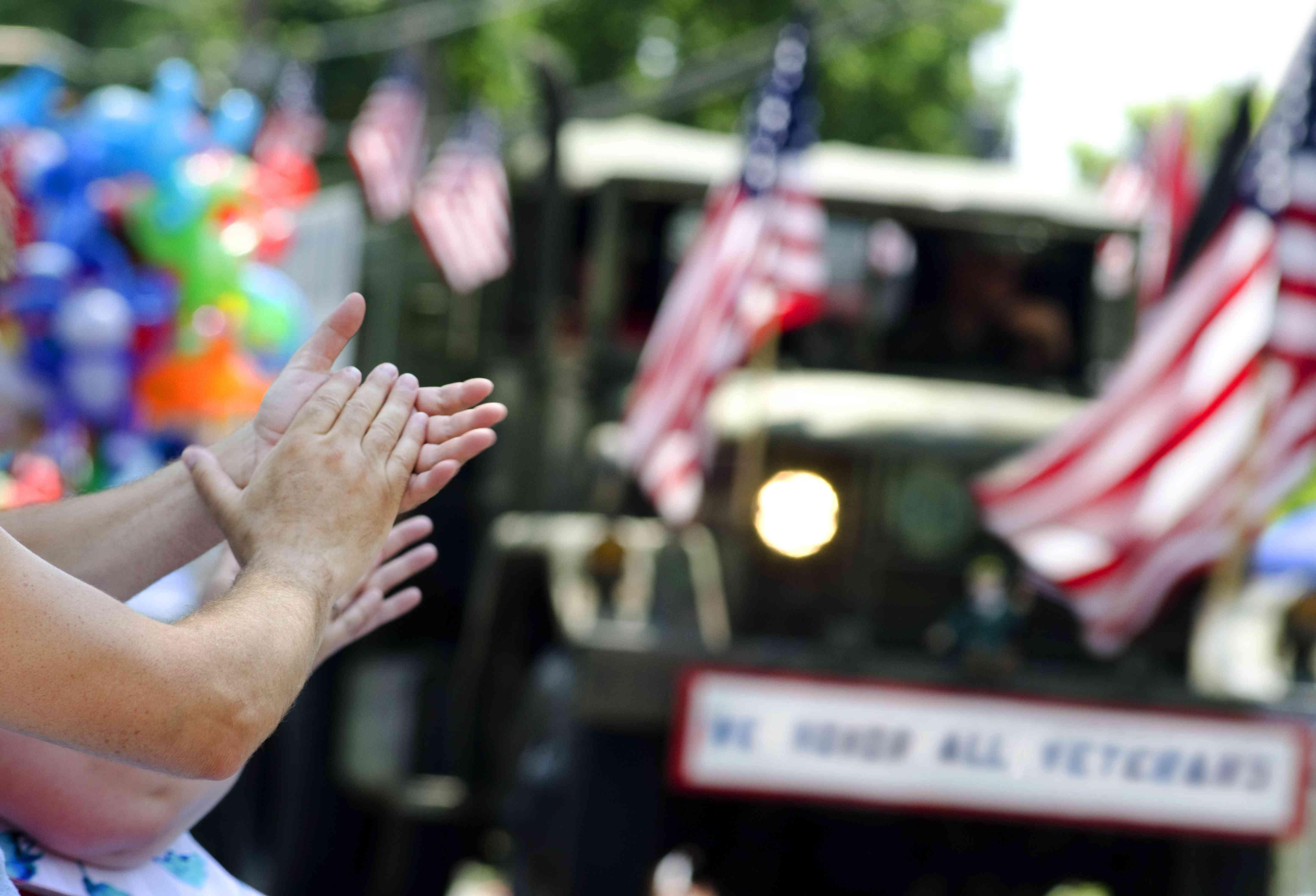 hands clapping at veterans parade