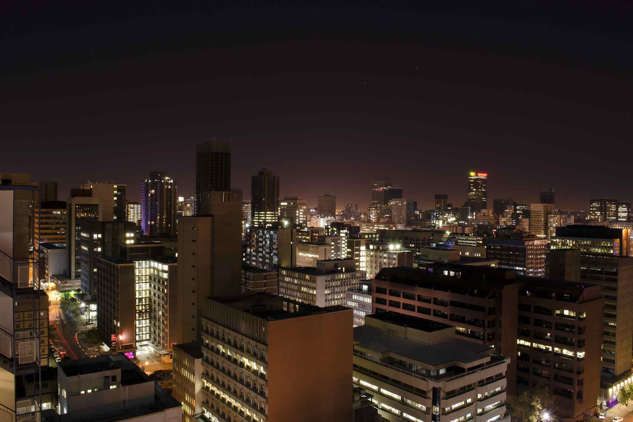A wide angle night shot of Braamfontein and the surrounding cityscape of downtown Johannesburg CBD, Johannesburg, Gauteng, South Africa.