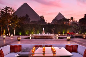square couch with the pyramids of giza in the background