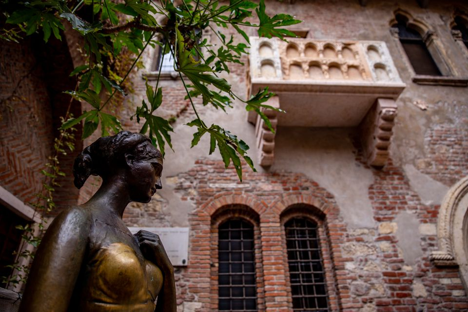Juliet's balcony and statue in Verona, Italy