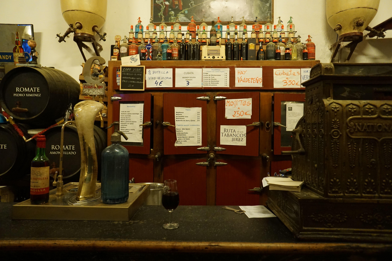 Vintage refrigerator and cash register at Tabanco Pandilla in Jerez