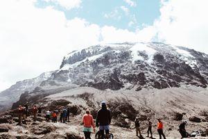 Hikers looking up at Mt Kilimanjaro